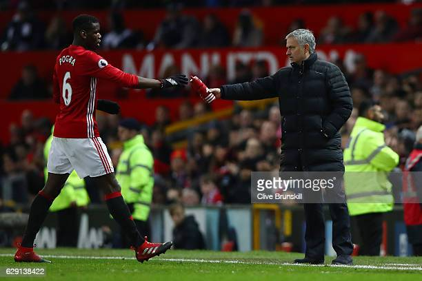 Jose Mourinho Manager of Manchester United passes a bottle to Paul Pogba during the Premier League match between Manchester United and Tottenham...