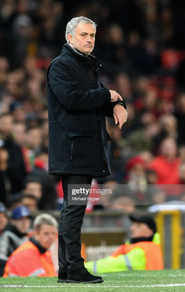 Jose Mourinho, Manager of Manchester United points at his watch as Vincenzo Montella manager of Sevilla reacts during the UEFA Champions League Round of 16 Second Leg match between Manchester United and Sevilla FC at Old Trafford on March 13, 2018 in Manchester, United Kingdom.