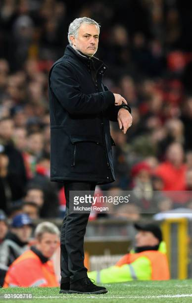 Jose Mourinho Manager of Manchester United points at his watch as Vincenzo Montella manager of Sevilla reacts during the UEFA Champions League Round...