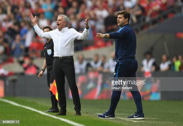 Jose Mourinho Manager of Manchester United reacts as Mauricio Pochettino Manager of Tottenham Hotspur gives his team instructions during The Emirates...