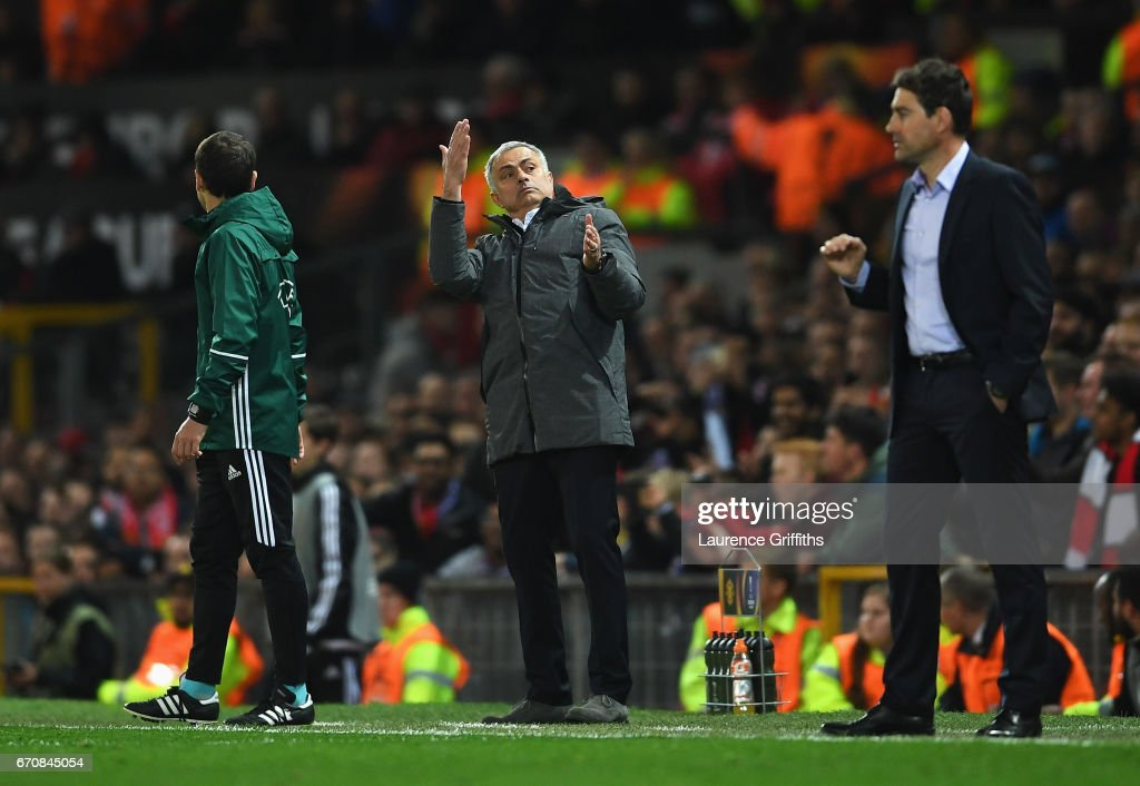 Jose Mourinho manager of Manchester United reacts as Rene Weiler head coach of RSC Anderlecht looks on during the UEFA Europa League quarter final second leg match between Manchester United and RSC Anderlecht at Old Trafford on April 20, 2017 in Manchester, United Kingdom.