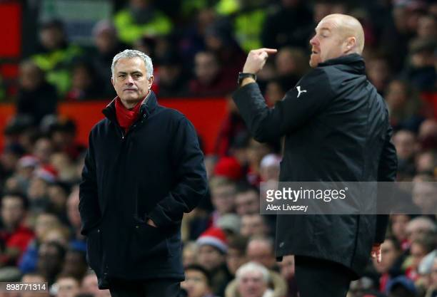 Jose Mourinho Manager of Manchester United reacts as Sean Dyche Manager of Burnley makes a point during the Premier League match between Manchester...