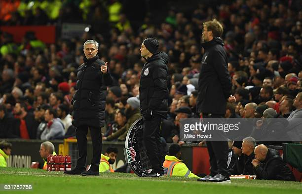 Jose Mourinho manager of Manchester United reacts towards fourth official Craig Pawson as Jurgen Klopp manager of Liverpool looks on during the...