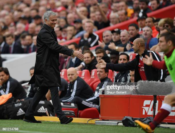 Jose Mourinho Manager of Manchester United shakes hands with a fan during the Premier League match between Liverpool and Manchester United at Anfield...
