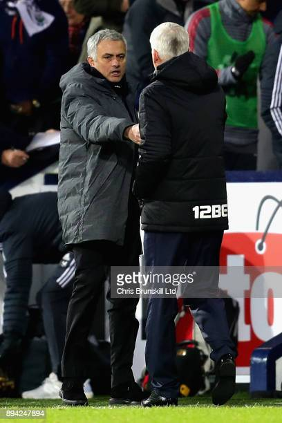 Jose Mourinho Manager of Manchester United shakes hands with Alan Pardew Manager of West Bromwich Albion after the Premier League match between West...