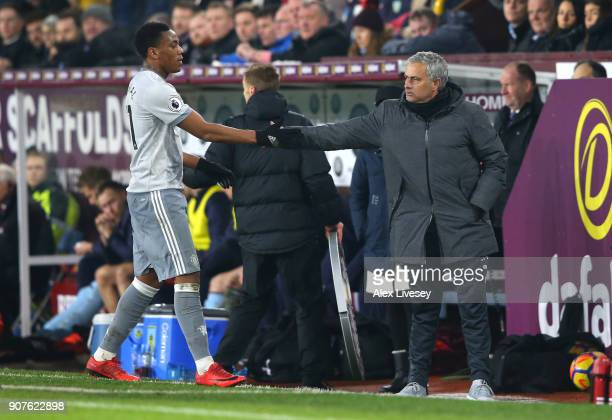 Jose Mourinho Manager of Manchester United shakes hands with Anthony Martial following the Premier League match between Burnley and Manchester United...