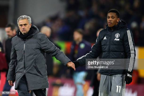 Jose Mourinho Manager of Manchester United shakes hands with goalscorer Anthony Martial of Manchester United after the Premier League match between...