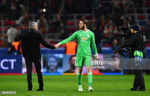 Jose Mourinho Manager of Manchester United shakes hands with David De Gea of Manchester United after the UEFA Champions League group A match between...