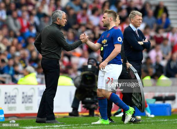 Jose Mourinho Manager of Manchester United shakes hands with Luke Shaw after his substitution during the Premier League match between Sunderland and...