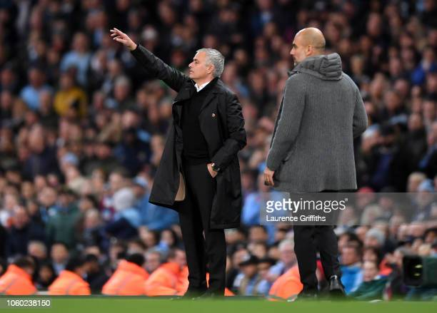 Jose Mourinho, Manager of Manchester United signals as Josep Guardiola, Manager of Manchester City looks on during the Premier League match between...