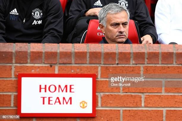 Jose Mourinho Manager of Manchester United sits in the home team dugout during the Premier League match between Manchester United and Manchester City...