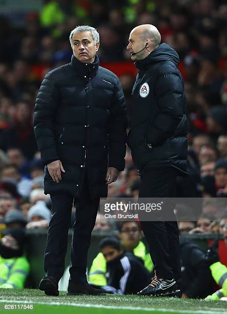 Jose Mourinho Manager of Manchester United speaks to Anthony Taylor the fourth offical during the Premier League match between Manchester United and...