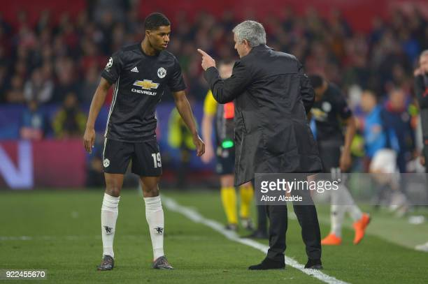 Jose Mourinho Manager of Manchester United speaks to Marcus Rashford during the UEFA Champions League Round of 16 First Leg match between Sevilla FC...