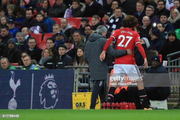 Jose Mourinho manager of Manchester United speaks to Marouane Fellaini after substituting him during the Premier League match between Tottenham...