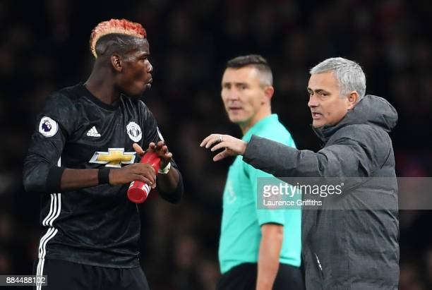 Jose Mourinho Manager of Manchester United speaks to Paul Pogba of Manchester United during the Premier League match between Arsenal and Manchester...