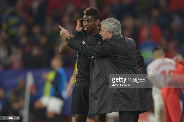 Jose Mourinho Manager of Manchester United speaks to Paul Pogba during the UEFA Champions League Round of 16 First Leg match between Sevilla FC and...