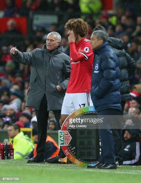 Jose Mourinho Manager of Manchester United speaks with Marouane Fellaini of Manchester United during the Premier League match between Manchester...