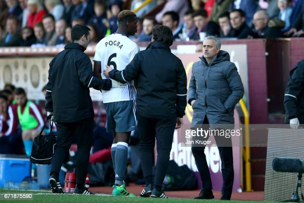 Jose Mourinho manager of Manchester United speaks with Paul Pogba of Manchester United as he walks off the pitch injured during the Premier League...
