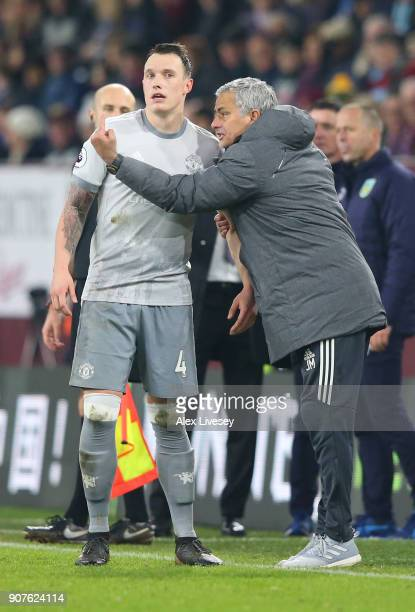 Jose Mourinho Manager of Manchester United speaks with Phil Jones during the Premier League match between Burnley and Manchester United at Turf Moor...
