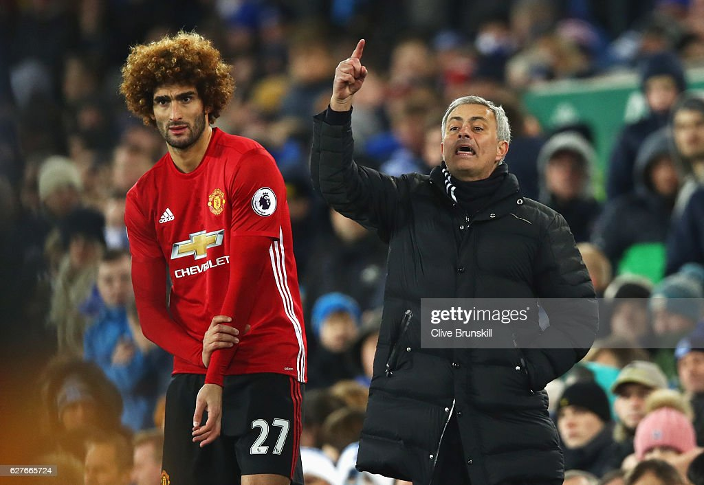 Jose Mourinho manager of Manchester United stands alongside substitute Marouane Fellaini of Manchester United during the Premier League match between Everton and Manchester United at Goodison Park on December 4, 2016 in Liverpool, England.