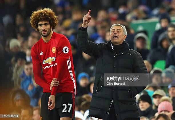 Jose Mourinho manager of Manchester United stands alongside substitute Marouane Fellaini of Manchester United during the Premier League match between...