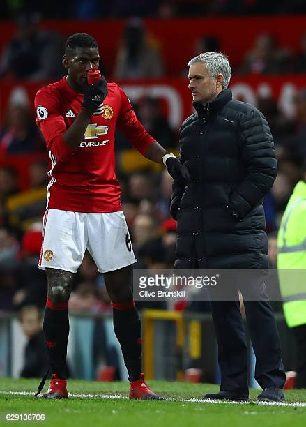 Jose Mourinho Manager of Manchester United talks to Paul Pogba during the Premier League match between Manchester United and Tottenham Hotspur at Old...