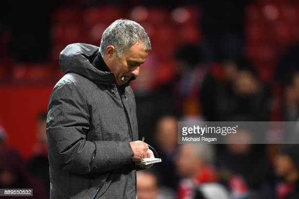 Jose Mourinho Manager of Manchester United writes in his notepad during the Premier League match between Manchester United and Manchester City at Old...