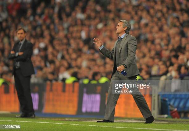 Jose Mourinho manager of Real Madrid gives instructions during the La Liga match between Real Madrid and Racing Santander at Estadio Santiago...