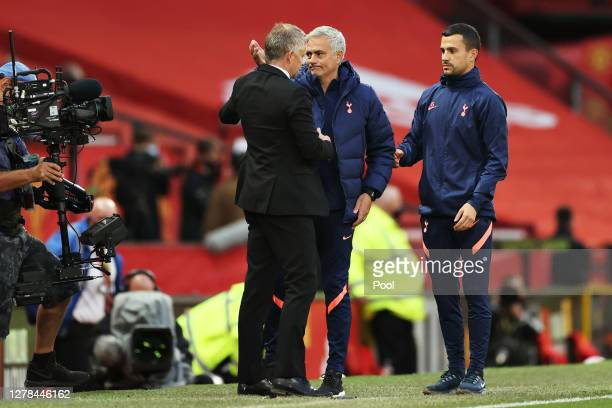 Jose Mourinho Manager of Tottenham Hotspur and assistant Joao Sacramento shake hands with Ole Gunnar Solskjaer Manager of Manchester United during...