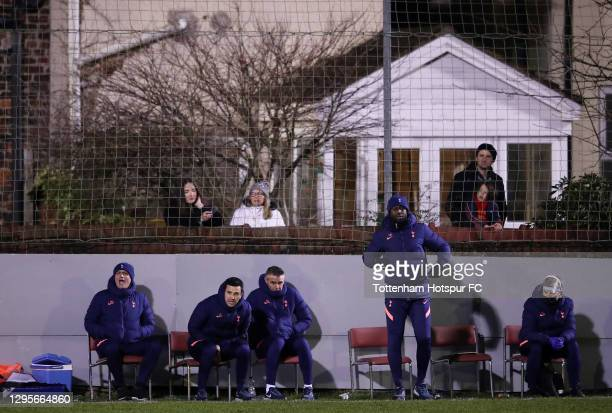 Jose Mourinho, Manager of Tottenham Hotspur and coaching staff Joao Sacramento, Nuno Santos and Ledley King react as fans are seen in the background...