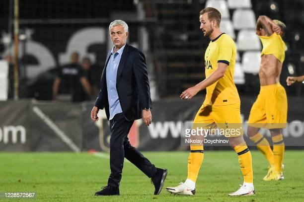 Jose Mourinho Manager of Tottenham Hotspur and Harry Kane of Tottenham Hotspur react following the UEFA Europa League second qualifying round match...