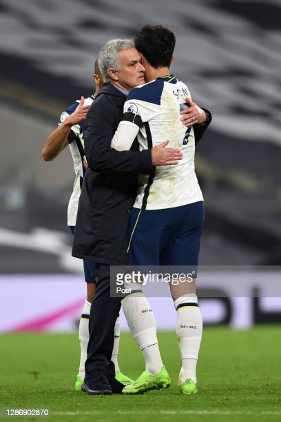 Jose Mourinho Manager of Tottenham Hotspur and HeungMin Son of Tottenham Hotspur celebrate following their team's victory in the Premier League match...