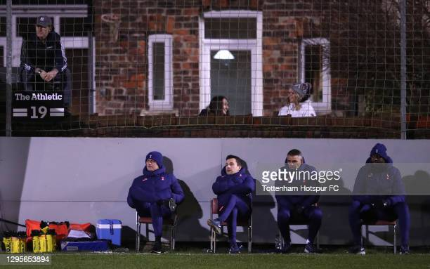 Jose Mourinho, Manager of Tottenham Hotspur and his backroom staff look on from the side of the pitch during the FA Cup Third Round match between...