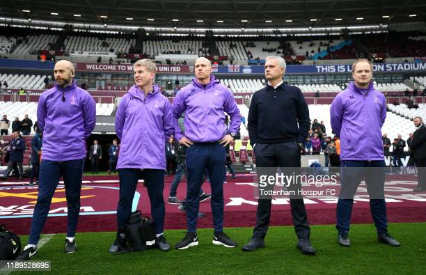 Jose Mourinho Manager of Tottenham Hotspur and his coaching staff look on prior to the Premier League match between West Ham United and Tottenham...
