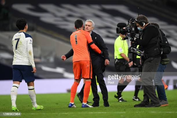 Jose Mourinho Manager of Tottenham Hotspur and Hugo Lloris of Tottenham Hotspur celebrate following their team's victory in the Premier League match...