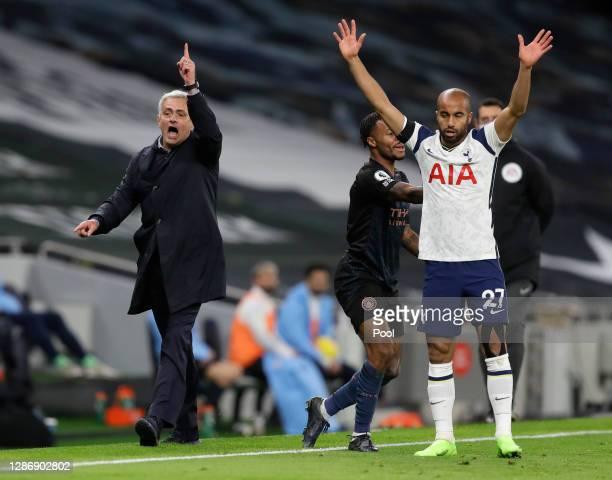 Jose Mourinho Manager of Tottenham Hotspur and Lucas Moura of Tottenham Hotspur react during the Premier League match between Tottenham Hotspur and...