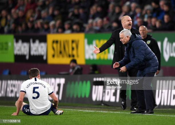 Jose Mourinho Manager of Tottenham Hotspur and Sean Dyche Manager of Burnley react to a situation involving Jan Vertonghen of Tottenham Hotspur...