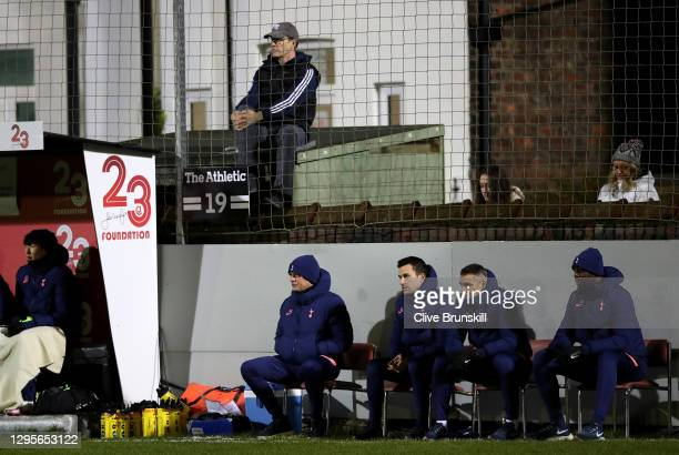 Jose Mourinho, Manager of Tottenham Hotspur and staff look on as fans watch the game from their garden during the FA Cup Third Round match between...