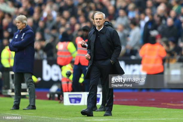 Jose Mourinho Manager of Tottenham Hotspur celebrates after his side score their first goal during the Premier League match between West Ham United...