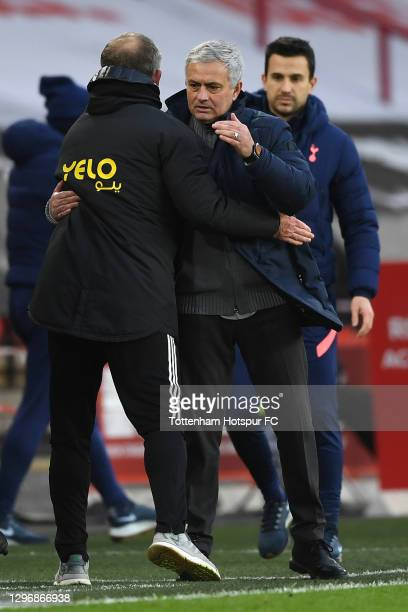 Jose Mourinho, Manager of Tottenham Hotspur embraces Chris Wilder, Manager of Sheffield United following the Premier League match between Sheffield...