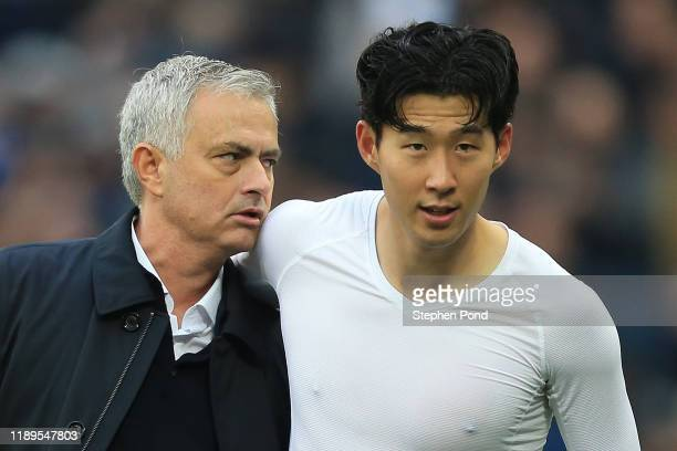 Jose Mourinho Manager of Tottenham Hotspur embraces HeungMin Son of Tottenham Hotspur during the Premier League match between West Ham United and...