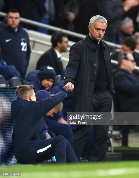 Jose Mourinho Manager of Tottenham Hotspur fist bumps a Tottenham Hotspur ball boy during the Premier League match between Tottenham Hotspur and AFC...