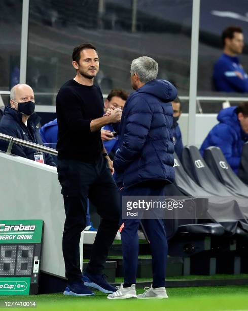 Jose Mourinho Manager of Tottenham Hotspur greets Frank Lampard Manager of Chelsea prior to the Carabao Cup fourth round match between Tottenham...