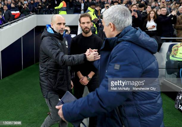 Jose Mourinho, Manager of Tottenham Hotspur greets Pep Guardiola, Manager of Manchester City prior to the Premier League match between Tottenham...