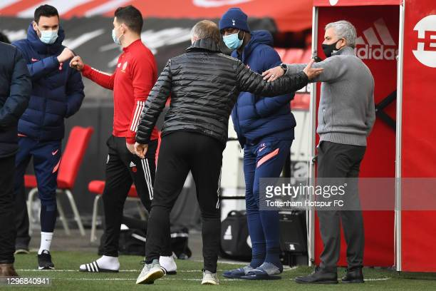 Jose Mourinho, Manager of Tottenham Hotspur interacts with Chris Wilder, Manager of Sheffield United prior to the Premier League match between...