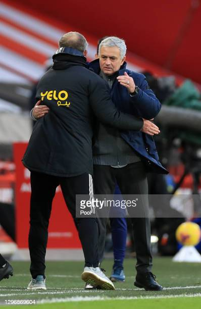 Jose Mourinho, Manager of Tottenham Hotspur interacts with Chris Wilder, Manager of Sheffield United following the Premier League match between...