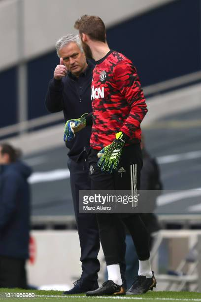 Jose Mourinho, Manager of Tottenham Hotspur interacts with David de Gea of Manchester United prior to the Premier League match between Tottenham...