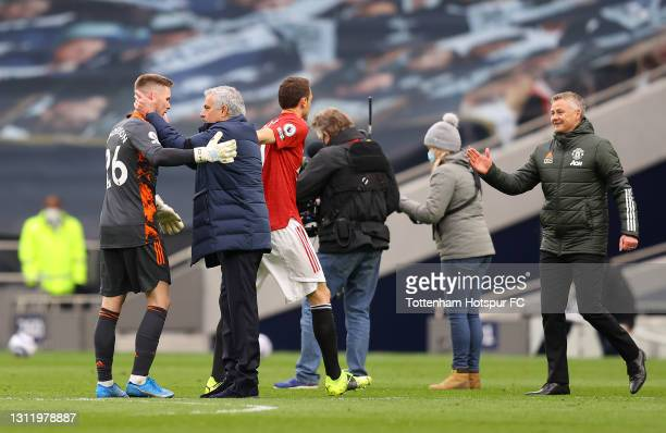 Jose Mourinho, Manager of Tottenham Hotspur interacts with Dean Henderson of Manchester United after the Premier League match between Tottenham...