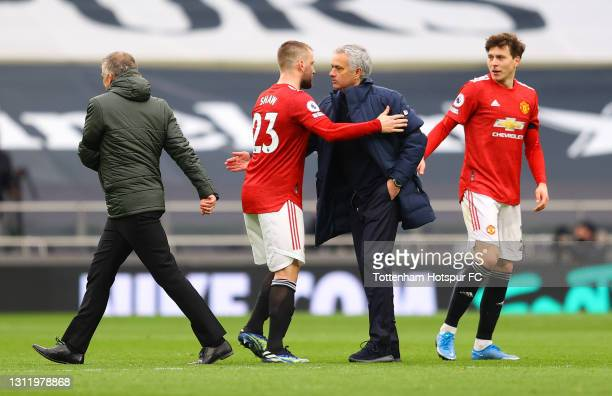 Jose Mourinho, Manager of Tottenham Hotspur interacts with Luke Shaw of Manchester United after the Premier League match between Tottenham Hotspur...