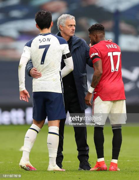 Jose Mourinho, Manager of Tottenham Hotspur interacts with Son Heung-Min of Tottenham Hotspur and Fred of Manchester United after the Premier League...
